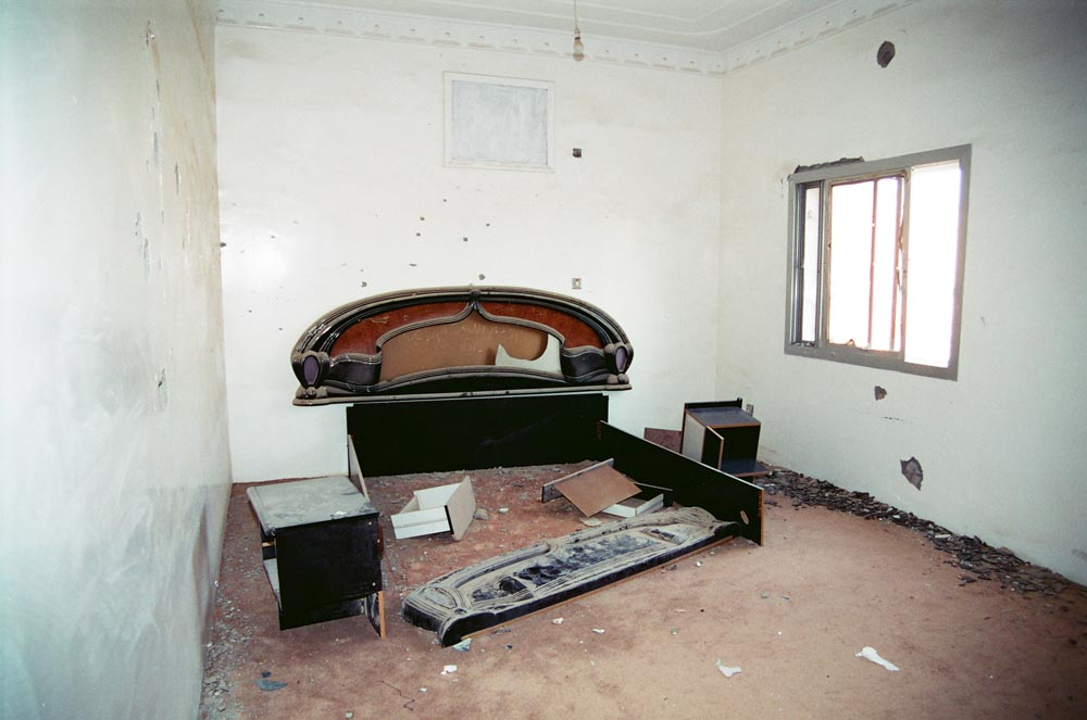 Al-Qurain House Interior in 1993  The bedroom of the homeowner and martyr, Bader Nasser Eidan. He survived the battle and was executed. (See also Overview pages 7 and Overview pages 9 and .)