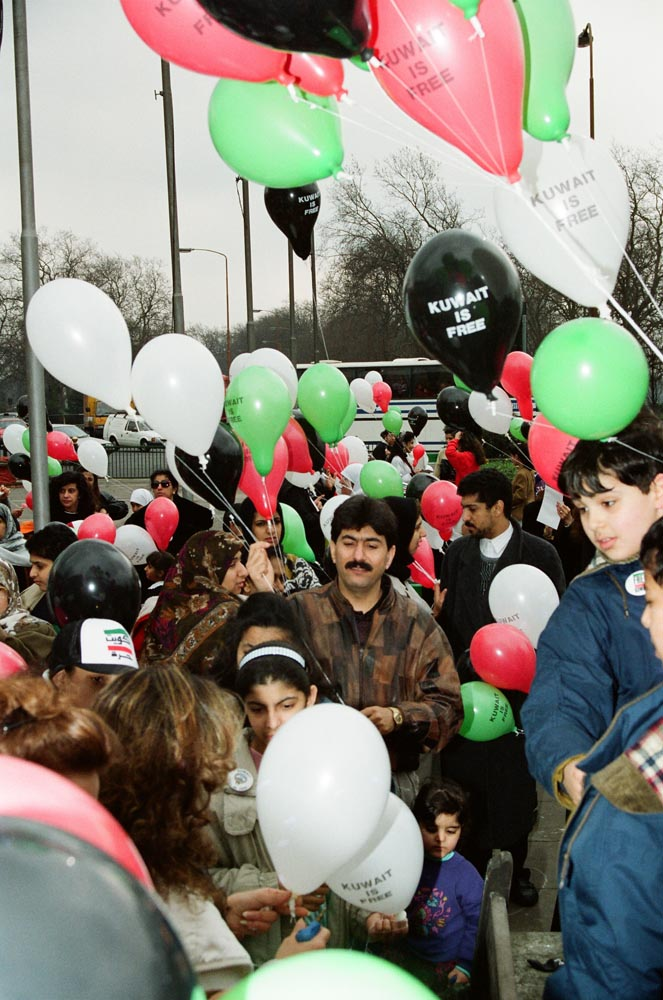 Free Kuwait Campaign  On February 26, news reached London that Iraqi troops had been driven out of Kuwait City. Iraqi troops were in retreat, the nation was liberated, and the Free Kuwait Campaign was over. Four days later, on March 2, Kuwaitis massed in the street to celebrate the liberation. They carried green, white, red, and black balloons - the colors of Kuwait's flag. Meanwhile, concerns arose for military POWs and civilian hostages held in Iraq. (See also Contact page. Visit www.freekuwait.org.kw for website about the FKC.) )