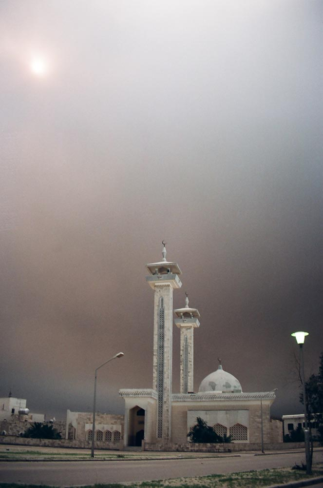 Mosque and Daytime Sky  Black smoke plumes from the oil fires blanketed the skies. Street lamps that were still operative had to be turned on during the day.