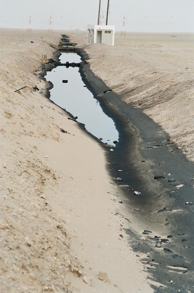 Oil-Filled Trench  During the retreat, Iraqi troops deliberately spilled oil into their trenches. The oil later seeped downward, contaminating soil and groundwater.