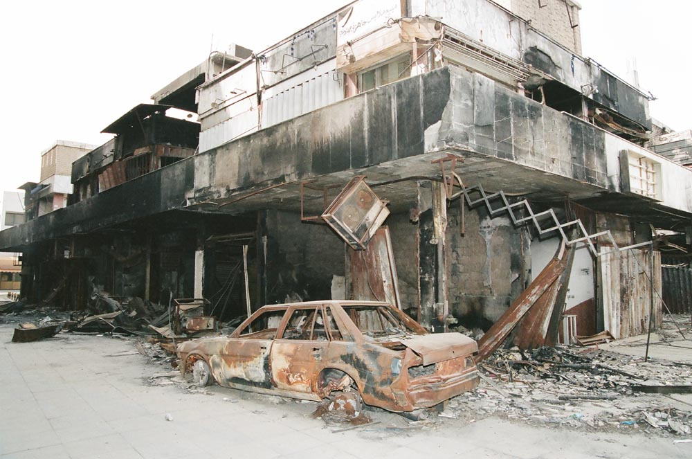 Old Souk Exterior  Near Abdullah Salem Street, this old marketplace was devastated by Iraqi troops. A stripped car was caught in the arson.