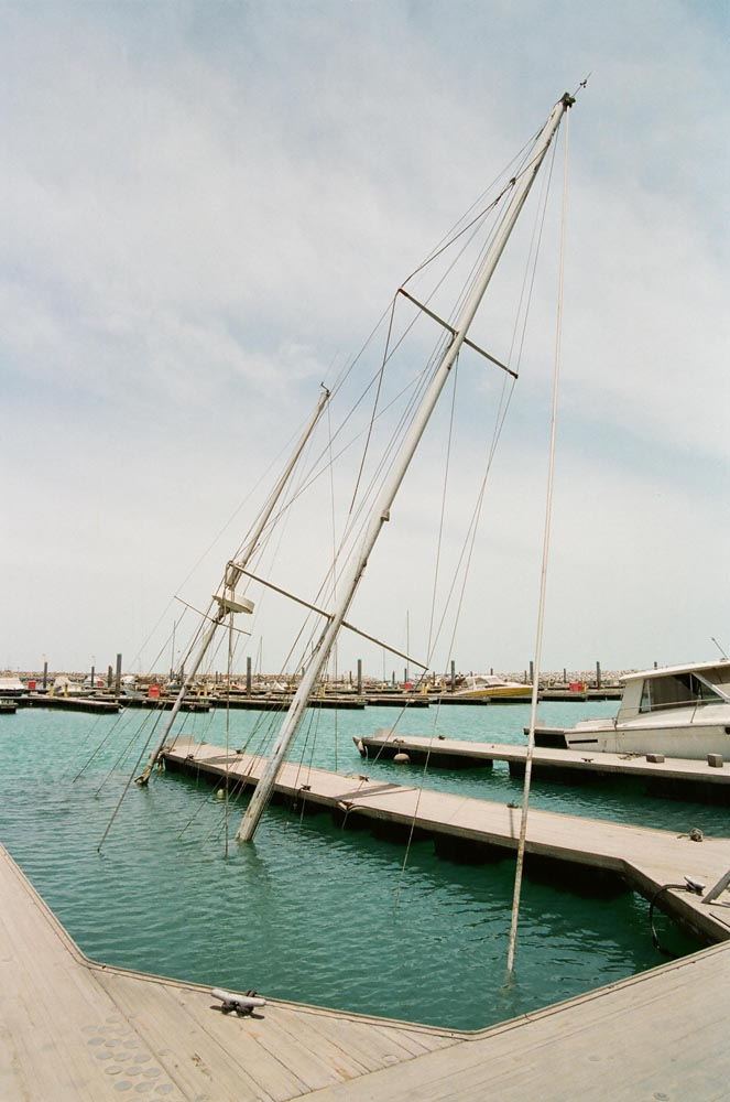 The Yacht Club Marina  A large sailboat sunk by Iraqi troops